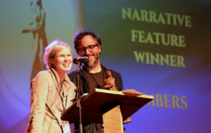 Claire Carre and Chales Spano accepting last year's Hoka Award at the Oxford Film Festival for their film EMBERS (Photo by Mike Stanton)