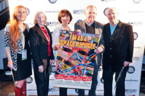 The I WAS A SPACE REFUGEE crew pose with their poster (Emily Cooley, Marion Tutor, Deborah Freedland, Glennray Tutor, Mark Alexander Carroll) (Photo by Bill Dabney)