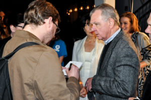 Glennray Tutor (I WAS A SPACE REFUGEE) explains his art to a reporter on the Oxford Film Festival red carpet (Photo by Bill Dabney)