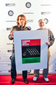 Team Millan with the poster shot for their film, STRONGER THAN BULLETS (Photo by Bill Dabney)