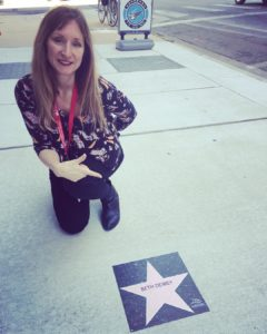 Beth Dewey, next to her star at the Tallgrass International Film Festival, last year