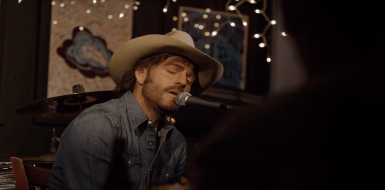 Stephen Dorff performing one of his songs as the title character in WHEELER
