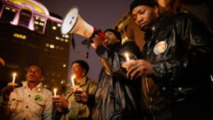 Protesting the lack of justice in the killing of Dontre Hamilton in BLOOD IS AT THE DOORSTEP