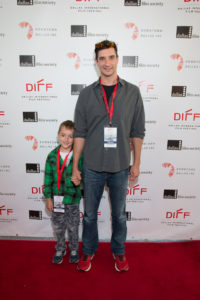 Luke Dienan Johnson with his father and director, Caleb Johnson of END OF EARTH (Photo by Cynthia Jordan/Selig Polyscope Company)