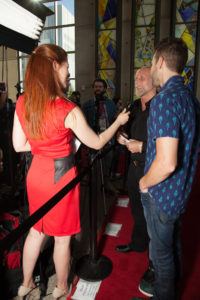Richard Turner and Luke Korem (DEALT) being interviewed. (Photo by Cynthia Jordan/Selig Polyscope Company)