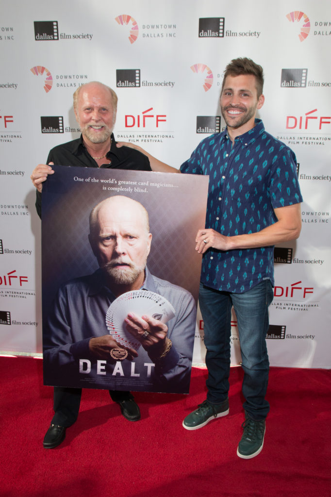 Richard Turner (Subject) and Luke Korem (Director) with the poster shot of DEALT (Photo by Cynthia Jordan/Selig Polyscope Company)