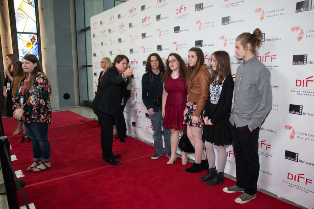Coaching the young filmmakers from the film SERENITY as to where to look for the photographers on the carpet. (Photo by John R. Strange/Selig Polyscope Company)