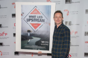 Cullen Hoback champions the poster for his film, WHAT LIES UPSTREAM (Photo by Steve Duffy/Selig Polyscope Company)
