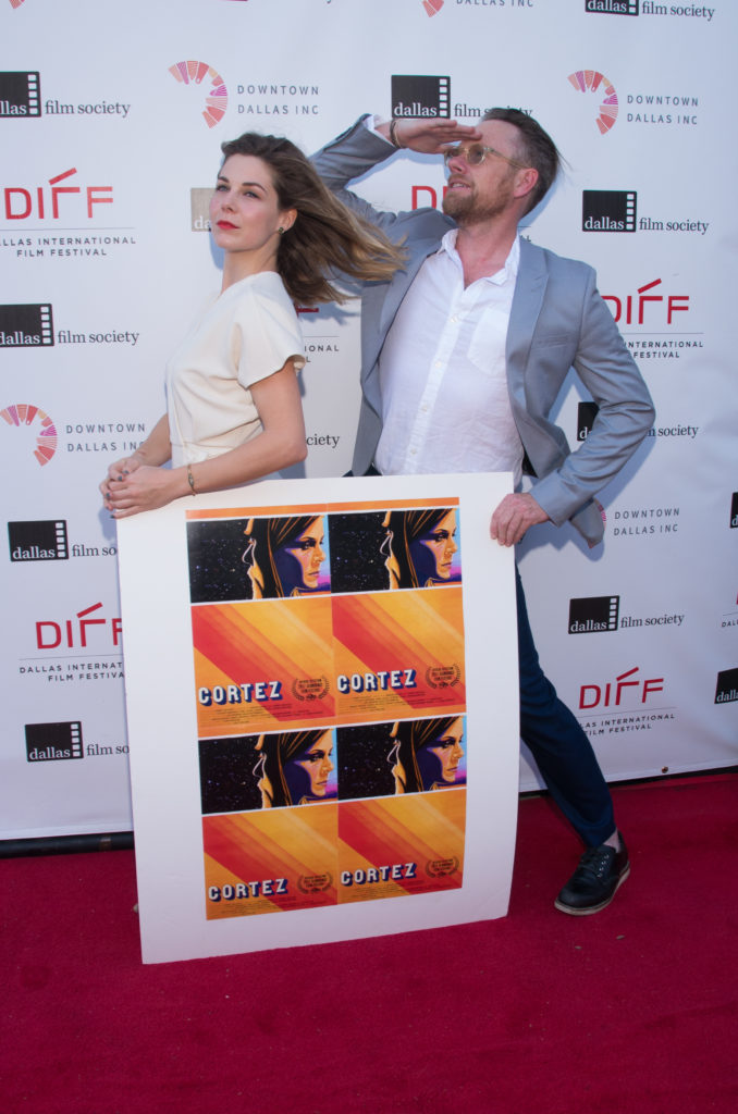 Cheryl Nichols and Arron Shiver of CORTEZ demonstrate how one should pose with their poster (Photo by Steve Duffy/Selig Polyscope Company)