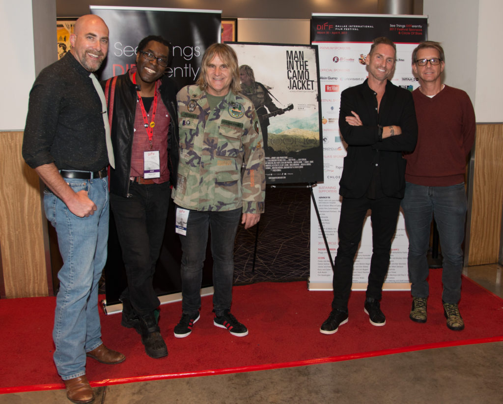 Dallas Morning News's Robert-Wilonsky and DIFF's James Faust with The Alarm's Mike Peters and James Chippendale and Jonathan McHugh (Producers) (MAN IN THE CAMO JACKET) (Photo by Tim Valis/Selig Polyscope Company)