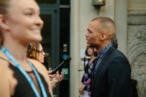 Kendrick Sampson being interviewed (How to Get Away With Murder) being interviewed (Photo by Lindsay Jones)