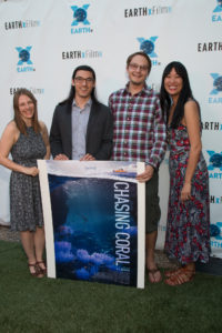 Larissa Rhodes (Producer), Jeff Orlowski (Director), Zackary Rago (Camera Operator), and Samantha Wright of CHASING CORAL with their film's poster (Photo by John R. Strange/Selig Polyscope Company)