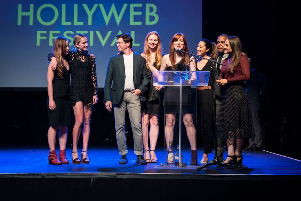 The cast and crew from Doomsday accept their award for Best Pilot.