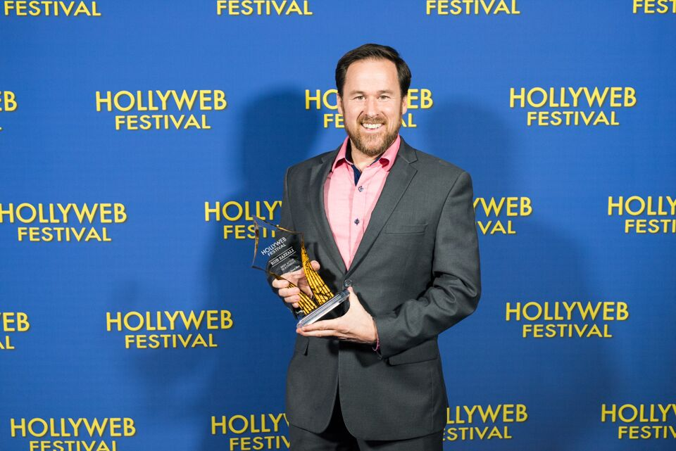 Rob Zazzali (RIGHT HAND MAN) with his award for Best Actor in a Comedy at the HollyWeb Festival