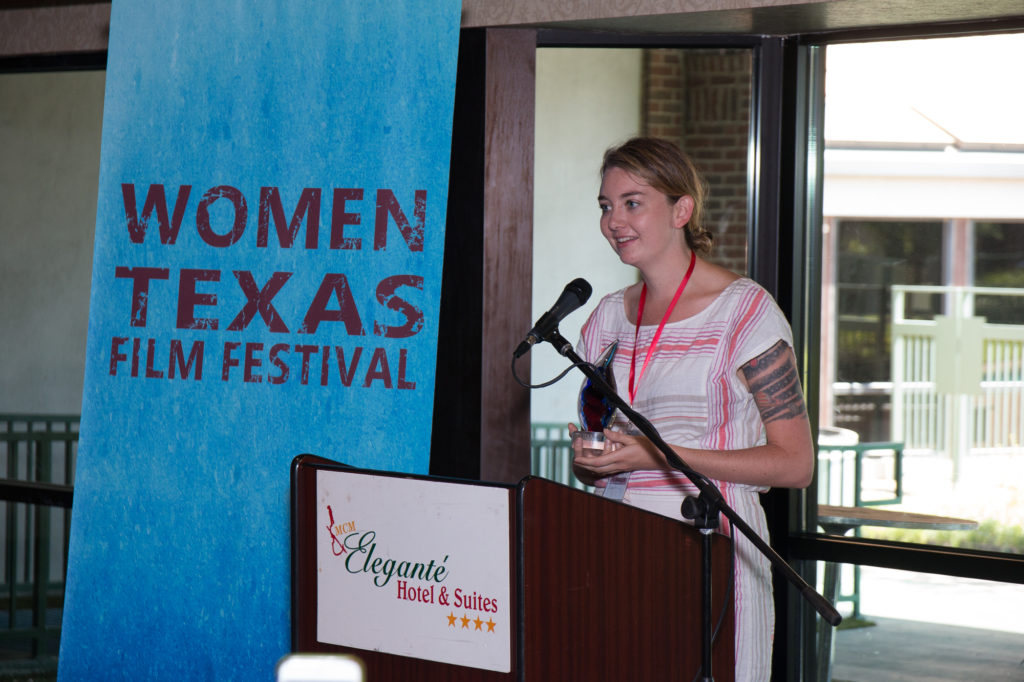 """Siena Pinney, accepting her """"Filmmaker to Watch"""" award at the Women Texas Film Festival on Sunday, August 20, 2017 (Photo by John Strange)"""