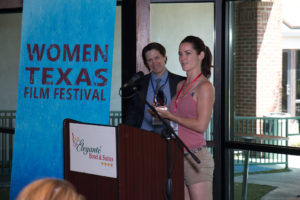 John Wildman, presenter, watches as Maja Aro, Director of HOODS, accepts the 2017 WTxFF Best Short Film award (Photo by John Strange)