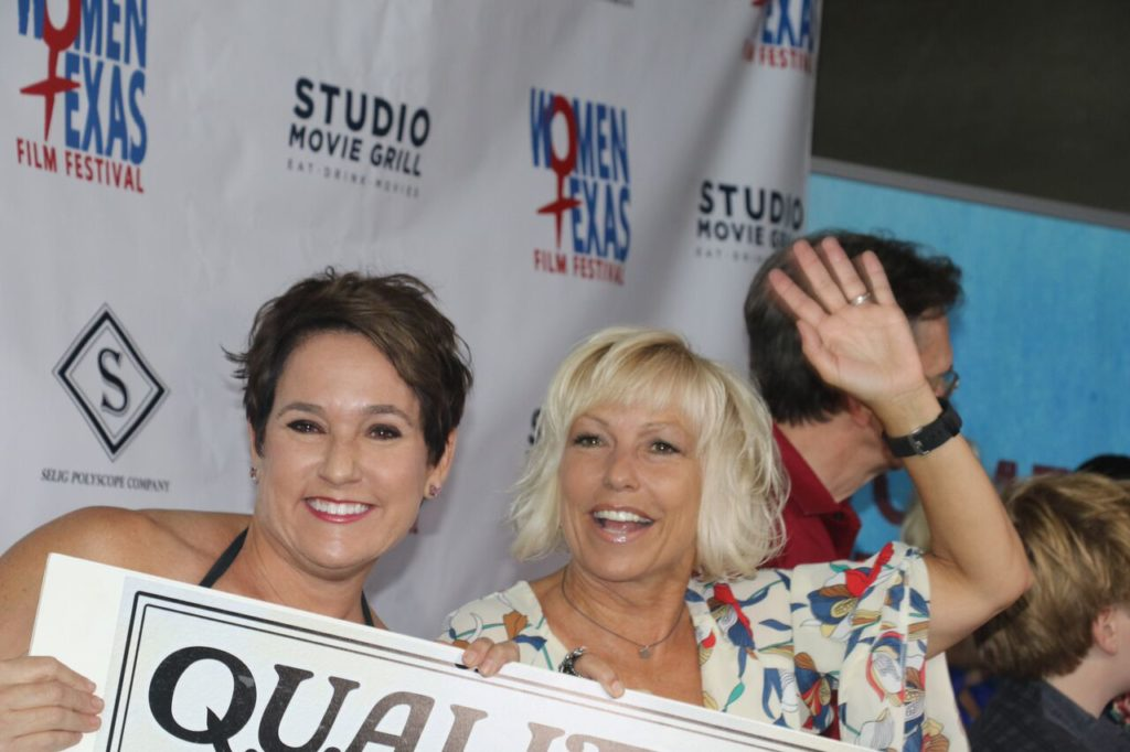 """Brooke Purdy (QUALITY PROBLEMS) finds time to work on her """"parade wave"""" during the red carpet. (Photo by Sandra Kent)"""