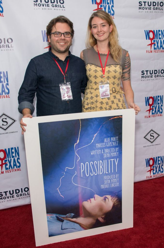 Michael Larson and Siena Pinney with their poster for POSSIBILITY. (Photo by John Strange)