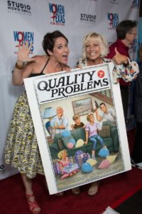 Colette Freedman and Brooke Purdy show off the QUALITY PROBLEMS poster. (Photo by John Strange)
