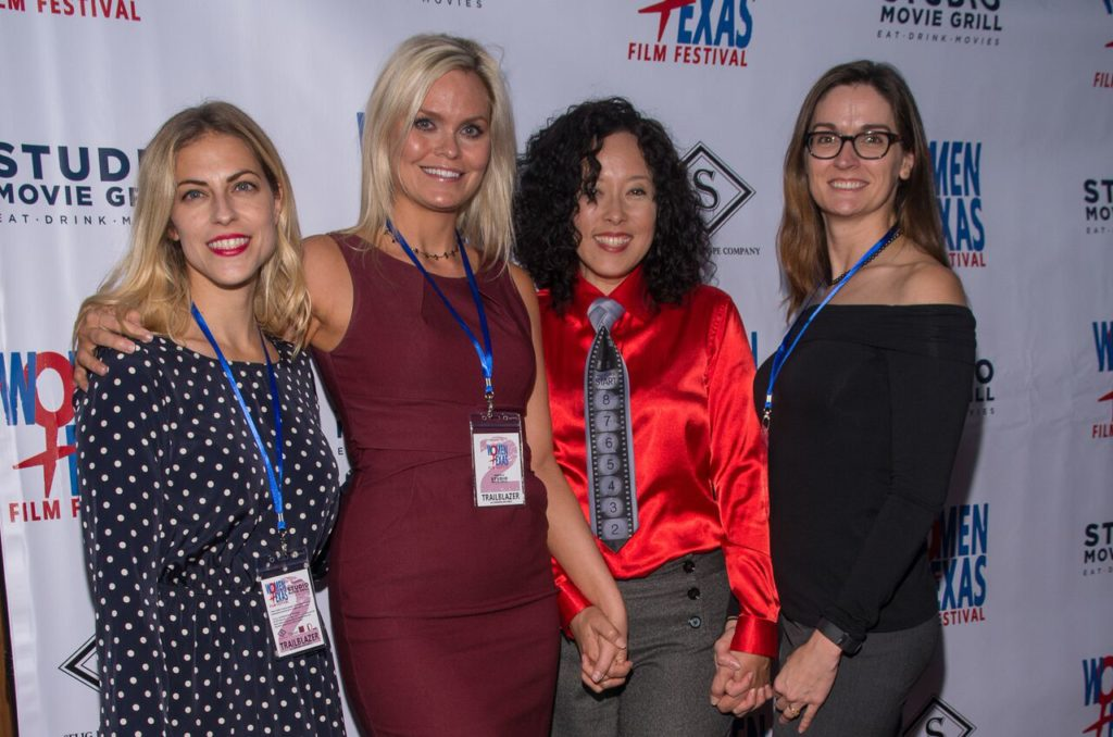 Women Texas Film Festival's Board Members Lisa Normand and Audrey Palmer flank Vanessa Cook and Justina Walford. (Photo by Steve Duffy)