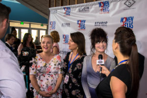 Maggie Rieth Austin, Amanda Austin, and Morgana Shaw, all being interviewed on a full red carpet. (Photo by Arthur Lefebvre)