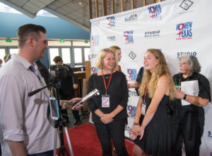 IT'S CRIMINAL's Signe Taylor and her daughter, Lyla Stettenheim being interviewed. (Photo by Arthur Lefebvre)