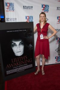 Sophia Woodward poses with the poster for her film LILITH'S AWAKENING. This is the largest film poster WTxFF has had yet. (Photo by John Strange)