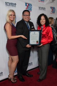 "Dallas City Councilman of the 6th District with the Official Proclamation to be presented to WTxFF'S Vanessa Cook (giving the sweet ""Price Is Right"" hand display) and Justina Walford (Photo by John Strange)"