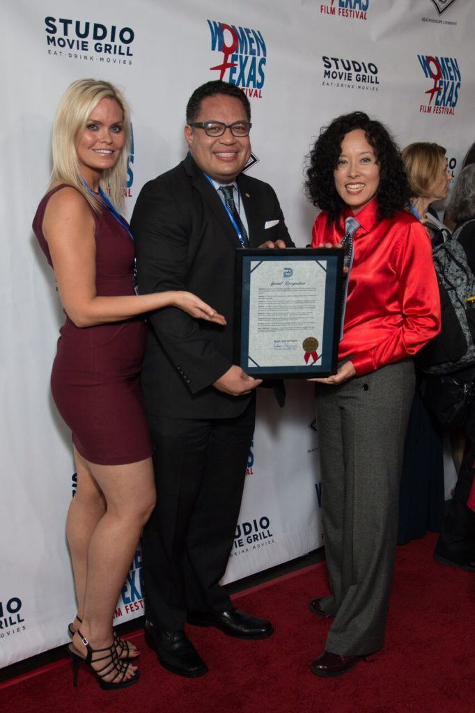 """Dallas City Councilman of the 6th District with the Official Proclamation to be presented to WTxFF'S Vanessa Cook (giving the sweet """"Price Is Right"""" hand display) and Justina Walford (Photo by John Strange)"""