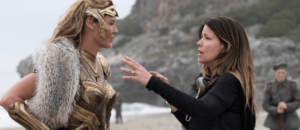 Here is a woman listening to another woman, Patty Jenkins, as she's being directed. It's like she had practice at listening or something.