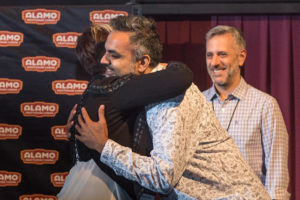 A lot of documentary filmmaker love: ABU's Arshad Khan gets a hug from Lisa Donato as Jeffrey Schwarz looks on (Photo by Erica Rich)