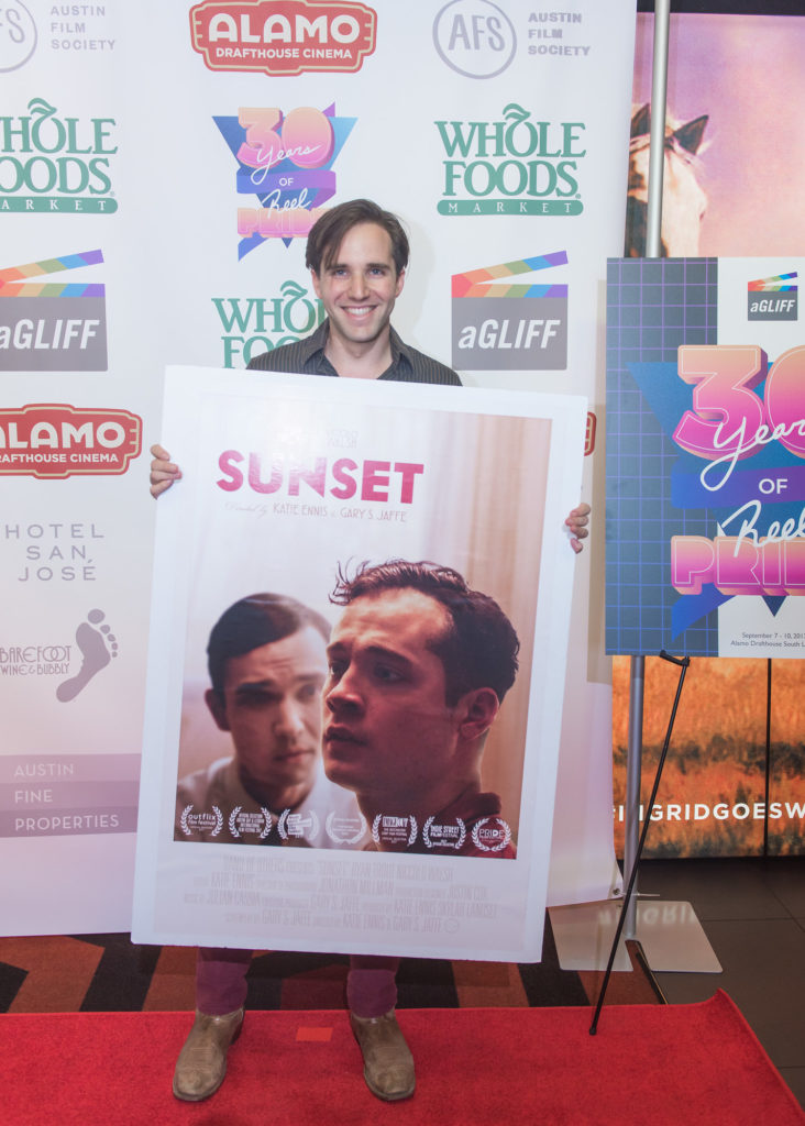 Gary Jaffe poses within poster for SUNSET (Photo by Erika Rich)