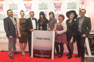 The TRANS YOUTH team with their film's poster (Photo by Erica Rich)
