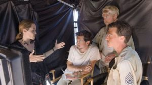 Holy crap! Three guys, THREE OF THEM, are listen to the words that are coming out of Angelina Jolie's mouth...