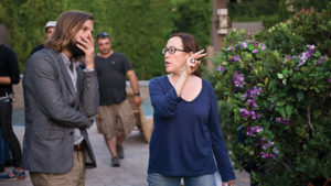 Here is a picture of Karyn Kusama directing a male actor.
