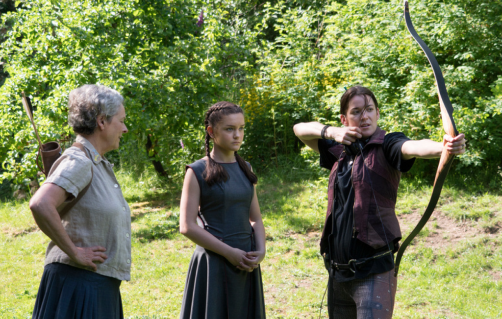 Either Maja Aro is demonstrating how to handle a bow properly to her actors, or she was really pissed about the meatloaf served at lunch that day.