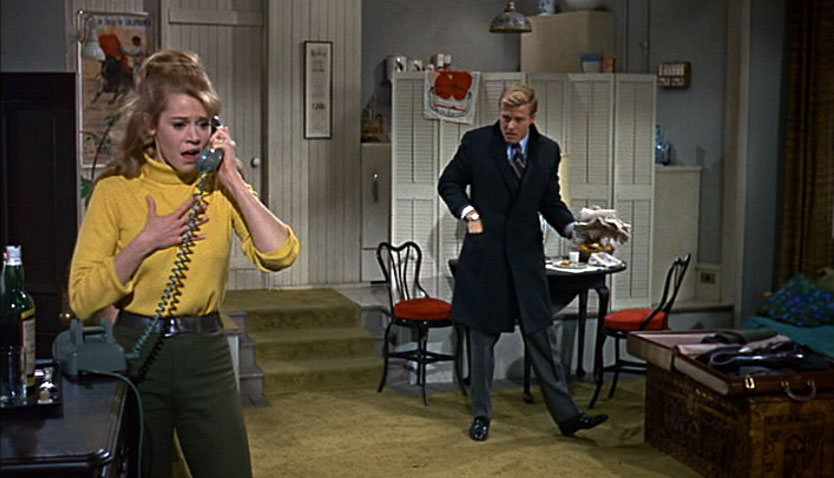 A very young Jane Fonda and Robert Redford in BAREFOOT IN THE PARK.