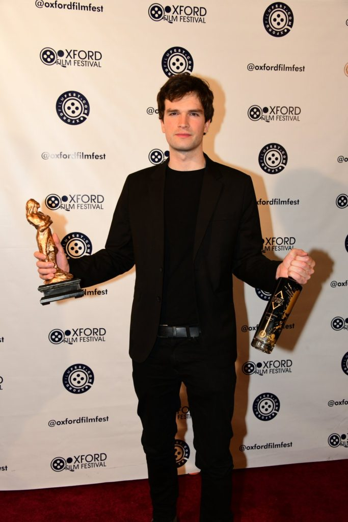 NATION DOWN director Liam Hendrix takes home the Hoka AND the vodka as the first Artist Vodka award-winner (Photo by Joey Brent)