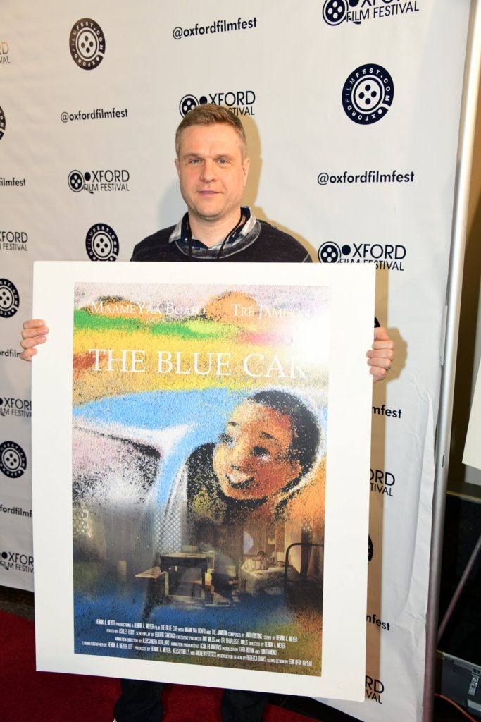 THE BLUE CAR's Henrik A. Meyerwith his film's poster. (Photo by Joey Brent)