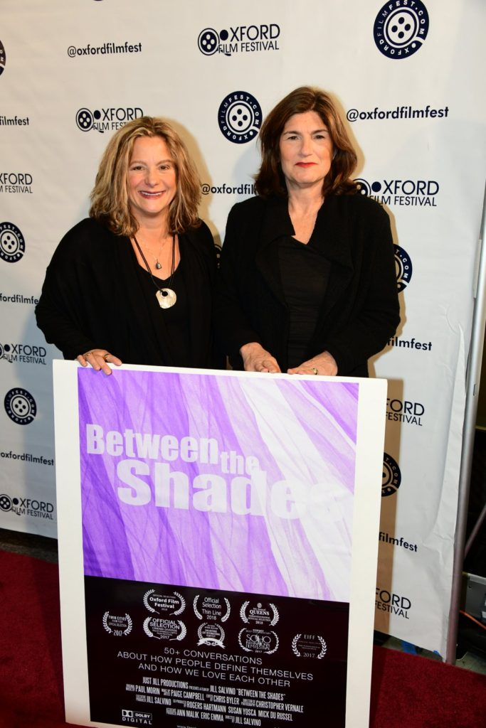 Jill Salvino (DIR) and Susan Padva Yosca (EXEC PROD) with their poster for BETWEEN THE SHADES. (Photo by Joey Brent)