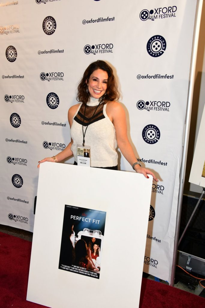 THE PERFECT FIT's Jolie Curtsinger with the film's poster. (Photo by Joey Brent)
