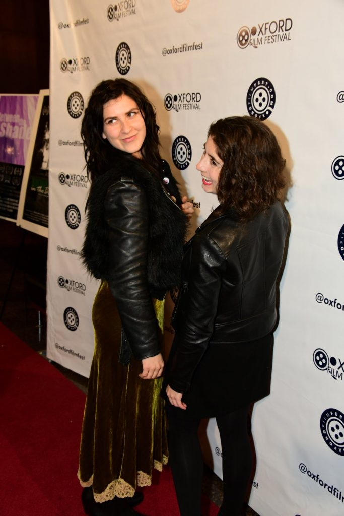 PARALYSIS's Marzy Hart and Victoria Negri give the photographers something to work with on the red carpet. (Photo by Joey Brent)