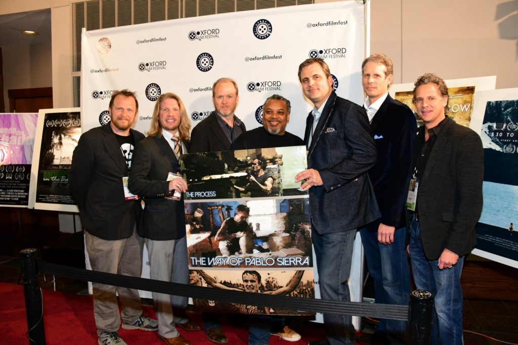 Posing with the poster: Matt Wymer (PROD/DP), Andrew George (ASSOC PROD), Jeff Dennis (DIR), Derek Brown (PROD), Brad Roberts (EXEC PROD), Doug Noble (EXEC PROD), John Scott (EXEC PROD) of THE PROCESS: THE WAY OF PABLO SIERRA (Photo by Joey Brent)