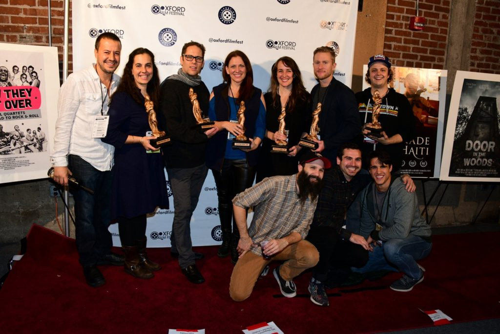 "Some of the Oxford Film Festival's 2018 Award winners: THE DRAWER BOY's co-directors Arturo Perez Torres, Aviva Armour-Ostroff, ""Twirling at Ole Miss"" screenwriter John Matthew Tyson, THE SOUNDING's director and star Catherine Eaton, LIYANA co-directors Amanda and Aaron Kopp, COP CHRONICLES' Mark Potts (DIR), and (kneeling) cast members Benjamin Crutcher, Joe LoCicero, Samir Forghani, Joe LoCicero (Photo by Joey Brent)"